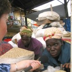 Claire Bolderson interviews market stall holder in Uganda
