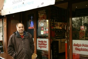 Mr Patel outside his cafe. His newsagents next door is now closed.